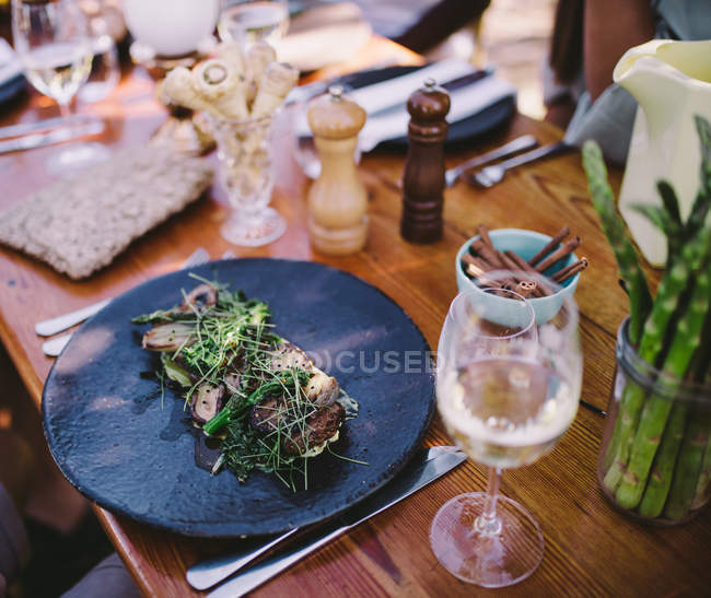 Close-up view of meat food and drink on a table — Stock Photo