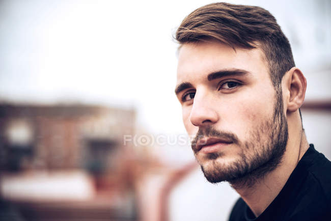 Handsome young caucasian man, male face with stubble — Stock Photo