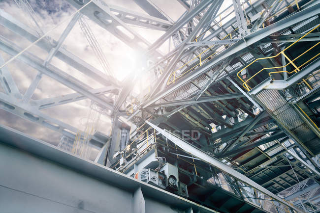 Low angle view of metallic at electricity generating station structures indoors — Stock Photo