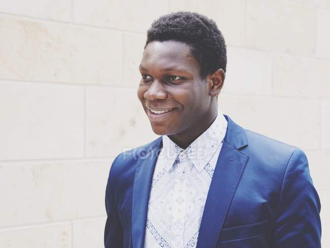 Smiling handsome african man in blue suit jacket — Stock Photo