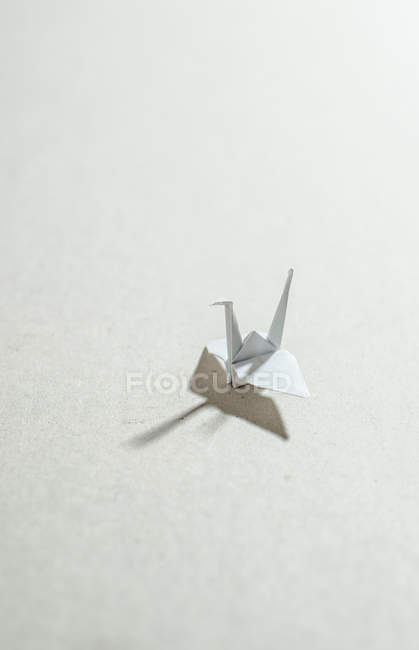 Paper Crane origami on white surface — Stock Photo