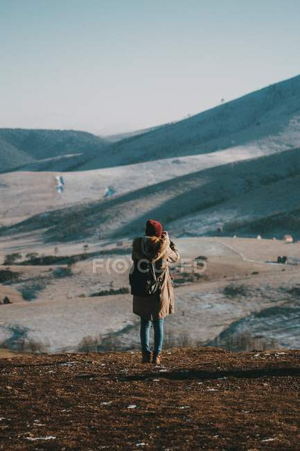 Full length of person photographing hills — Stock Photo