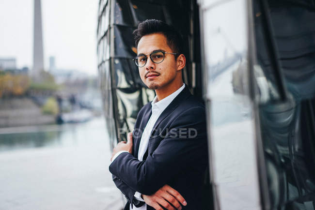 Well dressed young businessman with arms crossed — Stock Photo