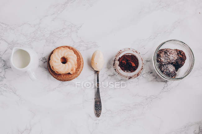 Top view of pastries on white marble top — Stock Photo