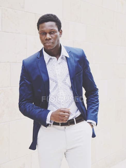 Handsome african man in blue suit jacket — Stock Photo