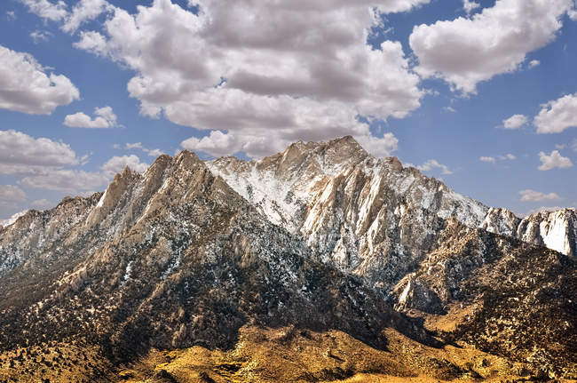 Scenic view of rocky mountains and cloudy sky — Stock Photo