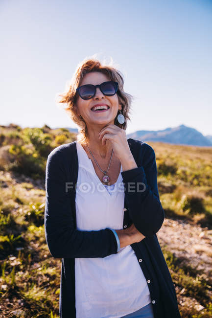 Female mature adult with sunglasses enjoying life smiling — Stock Photo