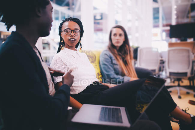 Group of young adults having a productive meeting in the office — Stock Photo