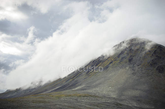 Scenic landscape view of mountains under cloudy sky — Stock Photo