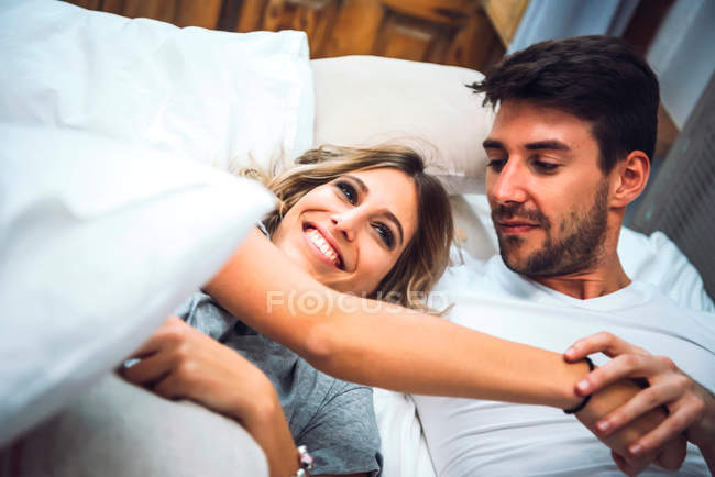 Lovely couple playing in bed — Stock Photo