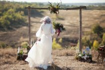 Beautiful bride, alfresco in countryside — Stock Photo
