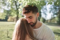 Young couple under tree — Stock Photo