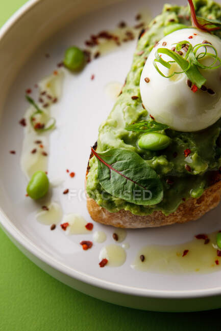 Closeup view of toast with guacamole and egg — Stock Photo