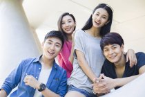 Chinese friends posing and looking in camera — Stock Photo
