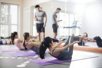 Asian women working with trainer at gym — Stock Photo