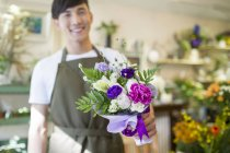 Male chinese florist holding bouquet of flowers — Stock Photo