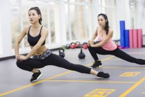 Asian women stretching at gym — Stock Photo