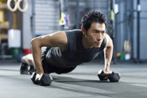Chinese man training with dumbbells — Stock Photo