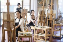 Asian women painting in art studio — Stock Photo