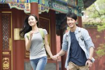 Chinese couple holding hands at Lama Temple — Stock Photo