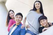 Chinese friends on street and looking in camera — Stock Photo