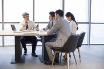 Business people having meeting in board room — Stock Photo