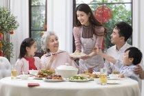 Family having Chinese New Year dinner — Stock Photo