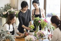 Asian women learning flower arrangement — Stock Photo