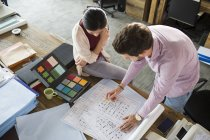 Architects working on blueprints in office — Stock Photo
