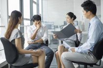 Chinese business team discussing work in meeting — Stock Photo