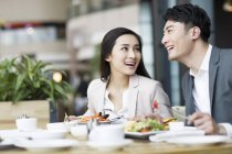 Chinese couple dining in restaurant — Stock Photo