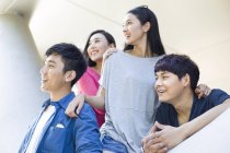 Chinese friends looking at view on street — Stock Photo