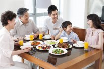 Chinese family of three generations having dinner together — Stock Photo