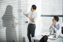 Chinese business team talking on meeting in board room — Stock Photo