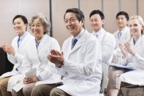 Medical workers clapping on meeting — Stock Photo