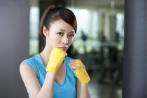 Portrait of Chinese woman in hand wraps — Stock Photo