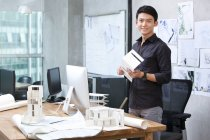 Chinese male architect standing in office — Stock Photo