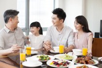 Chinese family with grandfather having dinner together — Stock Photo