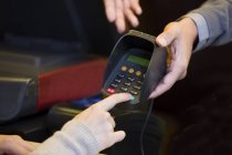 Close-up of customer entering credit card password — Stock Photo