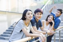 Chinese couple standing together with friends on street — Stock Photo