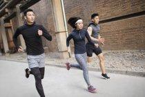 Chinese athletes running at street — Stock Photo