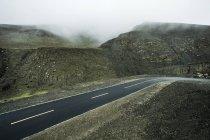 Thoroughfare in mountains of Tibet, China — Stock Photo
