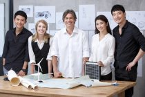 Portrait of international team of architects in office — Stock Photo