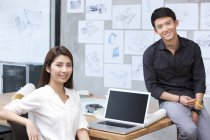 Chinese designers sitting in office — Stock Photo
