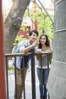 Chinese couple looking at bell at Lama Temple — Stock Photo