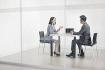 Chinese business people talking in meeting room — Stock Photo