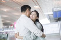 Mature chinese couple reuniting at airport — Stock Photo