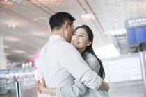 Mature chinese couple reuniting at airport — Stock Photo