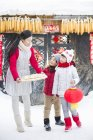 Mother and siblings with traditional Chinese dumplings in village — Stock Photo