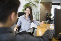 Female IT worker presenting digital tablet model in office — Stock Photo